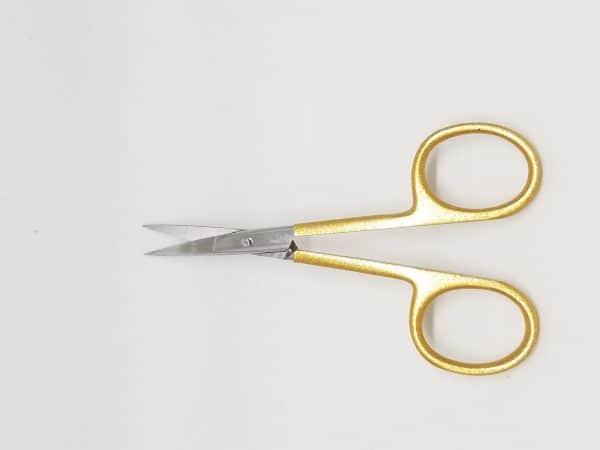 small gold scissor